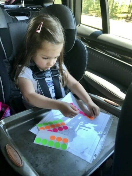 Isabella crafting using stickers