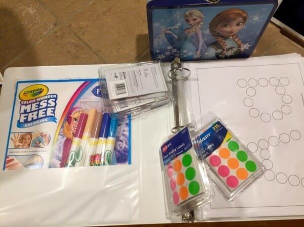 Markers, stickers and a tin LEGO adventure box