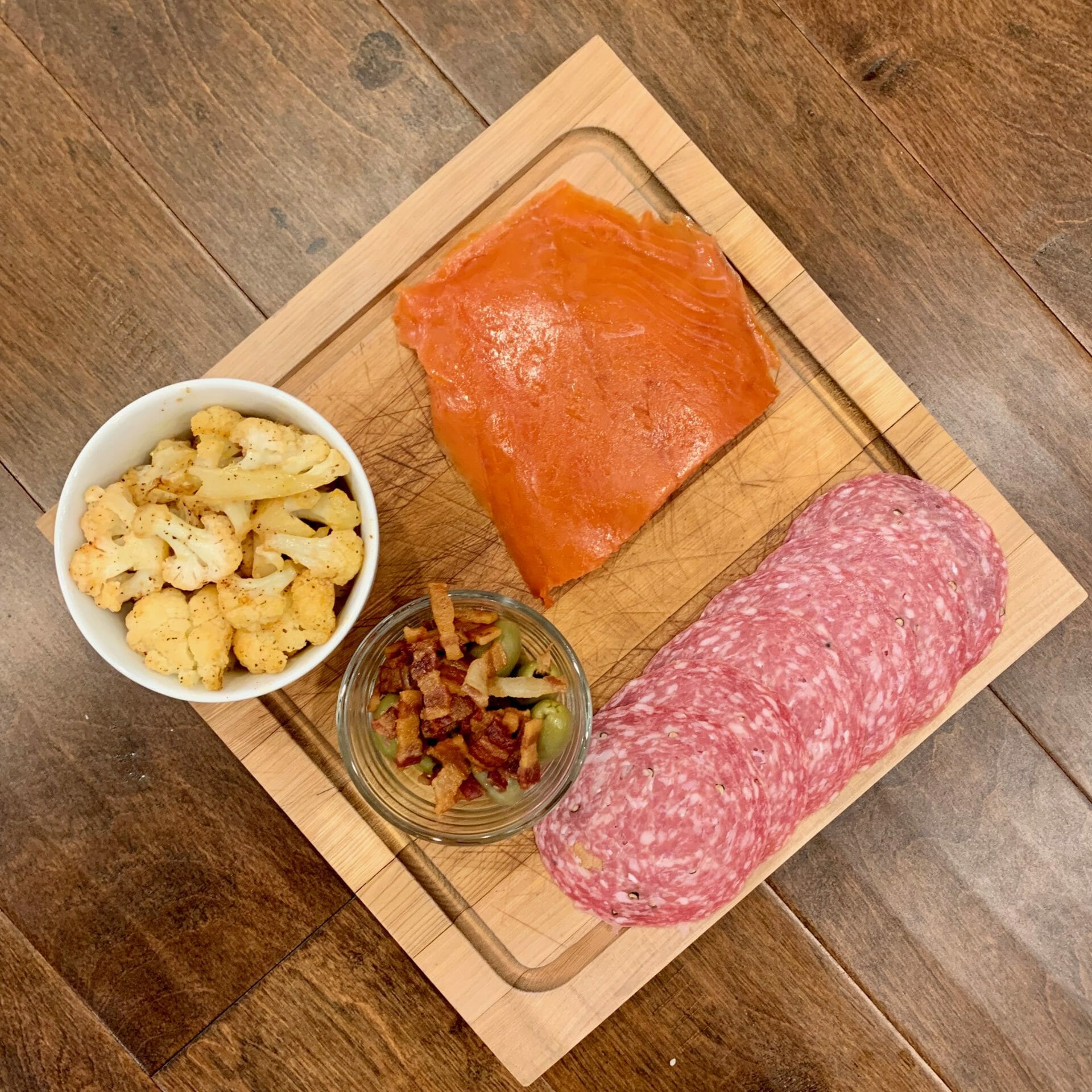 Smoked salmon, uncured salami, olives with bacon and fried cauliflower