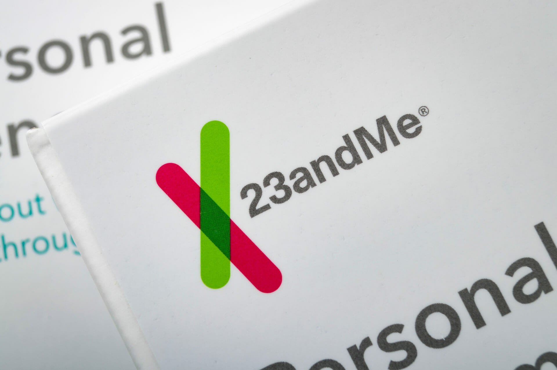 Illustrative editorial of two personal genome saliva collection kits - 23andMe