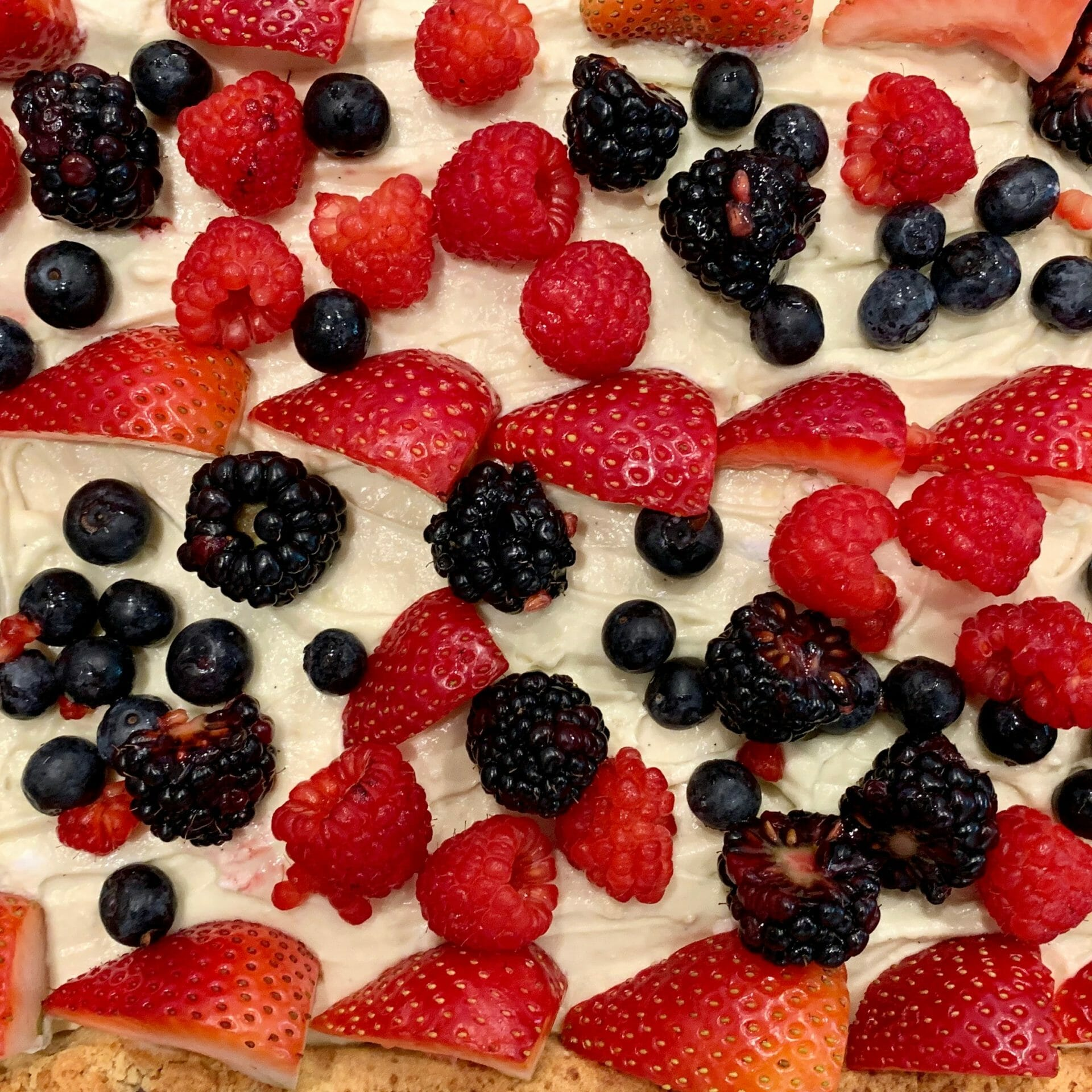 Paleo cake with mixed berries and a cream from coconut fat