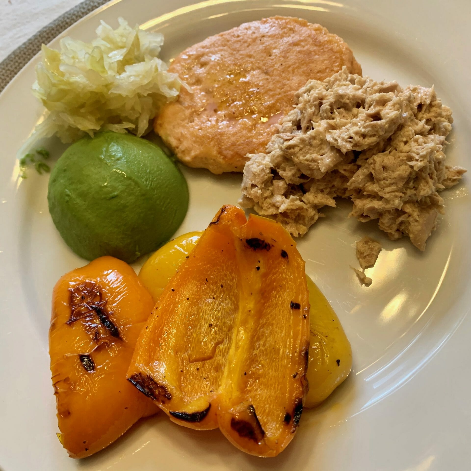 Salmon paddies (Costco) with canned tuna (and mayo), grilled peppers, avocado and sauerkraut