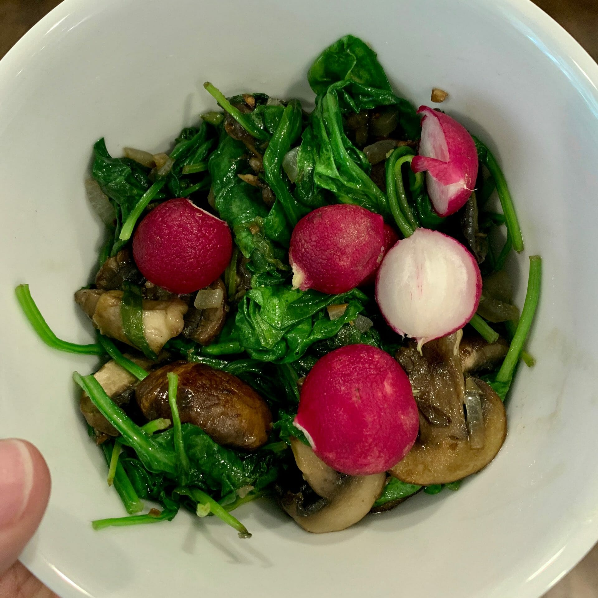 Sautéed spinach and mushrooms with radishes